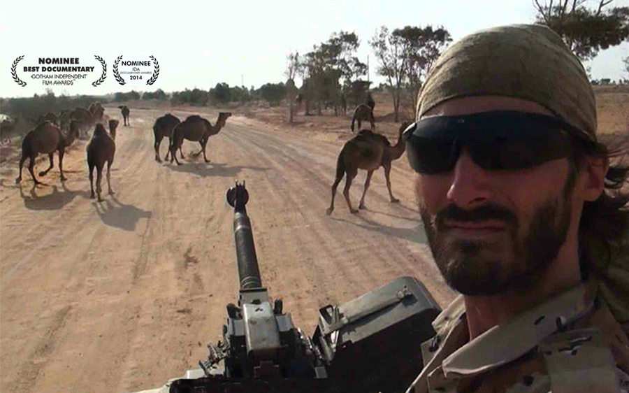 Matt VanDyke in Libya with camels